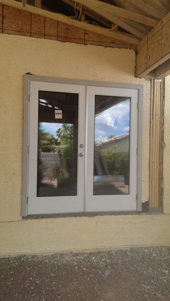 After With Hinged Patio Door Installed Nesco Construction